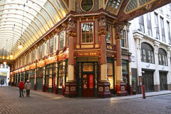 Leadenhall market covered mall city of london uk. London - Jan 17, 2009: unamed people walk  through the Victorian arcade of the Leadenhall Market, built in the Royalty Free Stock Photo