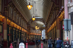 Leadenhall market decorated with British flags and lots of business people having a lunch. Royalty Free Stock Images