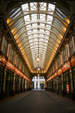 Leadenhall market shopping arcade london uk. Leadenhall market covered shopping arcade which dates back to the 14th Century in the city of london england Royalty Free Stock Photos