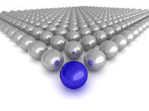 The leader. Abstract illustration of glossy spheres with a single blue 'leader', or 'winner' in the centre Royalty Free Stock Photos
