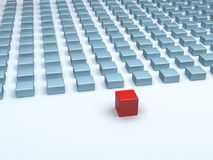 Leader. A red cube standing in front of many smaller cubes stock illustration