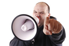 Leader. Man with an agressive expression screaming trough a megaphone royalty free stock image