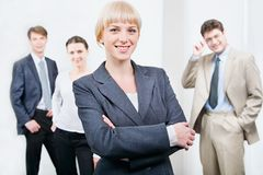 Leader. Photo of beautiful female leader on the background of her business team Royalty Free Stock Images