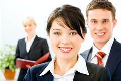 Leader. Portrait of successful leader with business team in the background Royalty Free Stock Photography