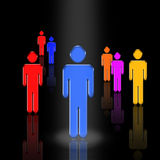 Leader. A figure stands in a spotlight surrounded by other figures Royalty Free Illustration