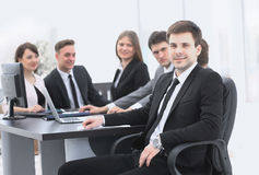 Leader on the background of business team