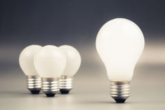 Leader. Big light bulb glowing with group of small light bulbs on background, leader, differentiation concept Royalty Free Stock Image