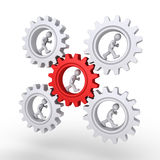 The leader is in the center of the workforce. 3d businessmen are running inside cogwheels but in the center is the leader Royalty Free Stock Photo