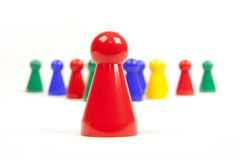 Leader concept. Colored pawns on white background Royalty Free Stock Images