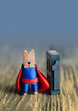 Leader concept. Clothespin superhero nimber one. 1 royalty free stock photography