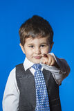 Leader, cute little boy portrait over blue chroma background. Child Stock Images