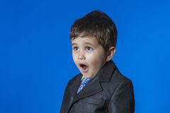 Leader, cute little boy portrait over blue chroma background Royalty Free Stock Photos