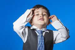 Leader, cute little boy portrait over blue chroma background. Child Royalty Free Stock Photos