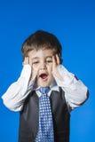Leader, cute little boy portrait over blue chroma background. Child Stock Photos