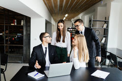 Leader discuss with team plans in office Royalty Free Stock Images