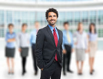 Leader in front of a group of business people Royalty Free Stock Images