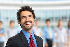 Leader in front of a group of business people Stock Photo