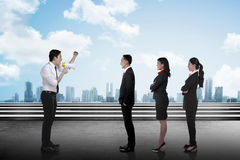 Leader give order via megaphone to his subordinate. Business communication concept Royalty Free Stock Photo