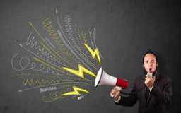 Leader guy shouting into megaphone with hand drawn lines and arr Stock Photo