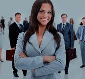 Business woman and her team. Leader and her team, Young attractive business people Royalty Free Stock Photography