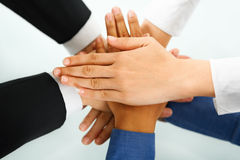 Leader and his employees hands in unity