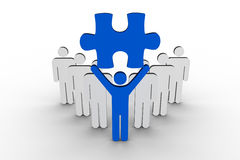 Leader holding blue jigsaw piece next to line of human figures. On white background Stock Image