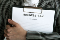 Leader holding a document business plan Stock Images