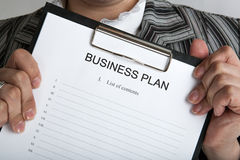 Leader holding a document business plan Stock Photo