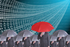 Leader holding red umbrella for show different think Stock Photography