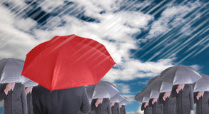 Leader holding red umbrella for show different think Stock Image