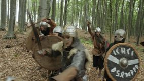 Leader Inspires his Viking with Battle Speech and Raises Sword during attacking.