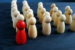 Leader or manager ahead of crowd. Figures from wood on a desk royalty free stock photography