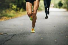 Leader of marathon young athlete runner Stock Photo
