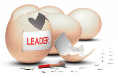 Leader. One egg broken by using a hammer with the word leader written on a sheet of paper, concept image for illustration of leadership Stock Photography