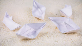 Without Leader. Paper Ships Chaotic Laying on Sandy in the Desert.  Royalty Free Stock Images
