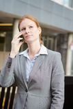 Leader on the Phone before an Office Building Stock Image
