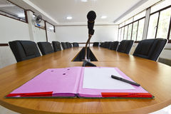 Leader position. Document file and micro phone on head of conference table Stock Photos