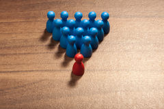 The leader, red leads blue figurines Stock Photo