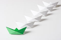 Leader ship. Origami leader ship and its fleet Stock Images