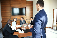 Leader showing business plan to colleagues during a meeting. Stock Photography