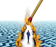 Leader Solutions. With a businessman walking through a complicated maze opened up by flames and fire lit by a match as a business concept of innovative thinking Stock Photography