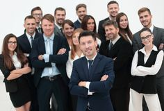 Leader standing in front of a large business team Stock Image