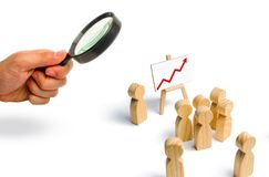 The leader is standing near the graph with a red up arrow speaks. A speech addressing a crowd of people. Business concept of leader and leadership qualities royalty free stock photography