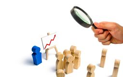 The leader is standing near the graph with a red up arrow speaks royalty free stock image