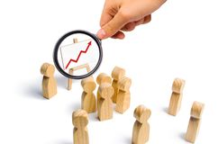 The leader is standing near the graph with a red up arrow speaks. A speech addressing a crowd of people. Business concept of leader and leadership qualities royalty free stock image