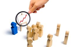The leader is standing near the graph with a red up arrow speaks stock photography