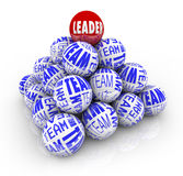Leader and Team - Balls Forming Pyramid. Many balls with the words Team and one reading Leader forming a pyramid symbolizing the cooperation within an Stock Images