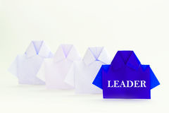 Leader word on One blue among white origami shirt paper , unique Stock Photos