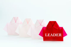 Leader word on One Red among white origami shirt paper , unique Stock Photos
