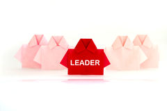 Leader word on One Red among white origami shirt paper , unique Royalty Free Stock Image